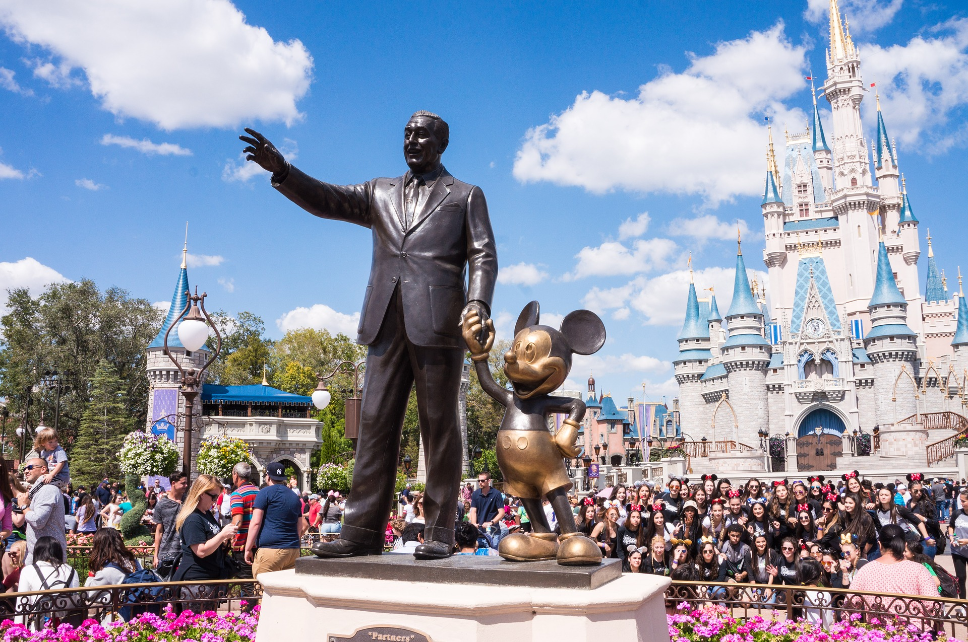A picture of the Walt Disney statue at Disneyland to symbolise the live action movies on Disney+
